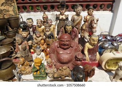 Buddha, spirit nats and alarm clocks for sale in central market, Shwedagon Pagoda Yangon (Rangoon),  Myanmar (Burma)
