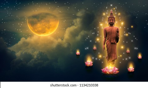 Buddha standing on a lotus in the sky at night The big moon is the background