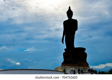 Buddha standing in Silhouette ,Phutthamonthon Nakhonpathom, It is a large public park for people to relax, exercise and worship.