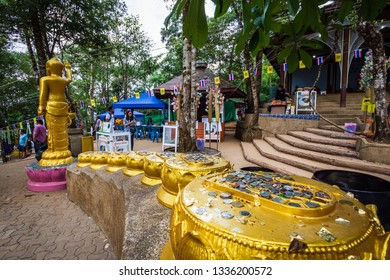 Buddha statue beautiful On the way up at The stone with the footprint of Lord Buddha at Khitchakut mountain It is a major tourist attraction Chanthaburi, Thailand.February 16, 2019