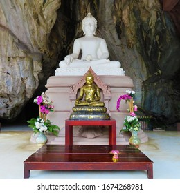 The buddha statue in the cave.