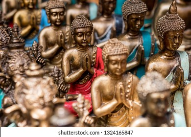 Buddha statue figures sold as a traditional souvenir on Ubud market, Bali, Indonesia.