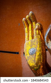 Buddha statue hand with lotus flower at Wat Tham Sua, Kanchanaburi, Thailand Golden buddha hand stucco made from glass mosaic Asia, Buddha, Buddhism, Buddhist, Buddhist temple.