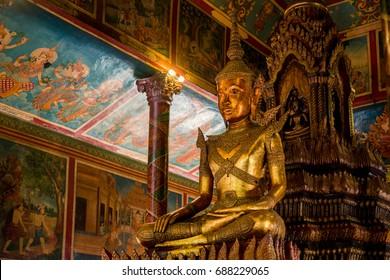 Buddha statue Inside the pagoda Wat Phnom, Cambodia, the land of Buddhism