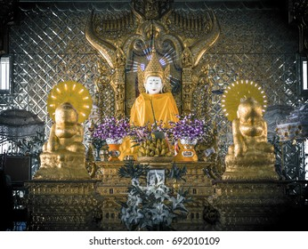 The Buddha statue inside the temple at Phaung Daw Oo temple in Mogok, Myanmar