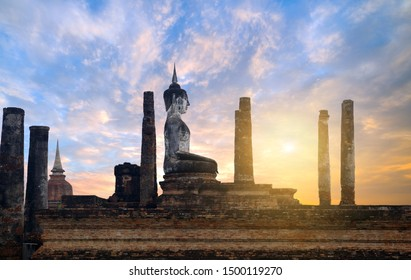Buddha statue meditating posture at Wat Mahathat temple in the precinct of Sukhothai Historical Park, a UNESCO World Heritage Site in Thailand,Aisa A beautiful day in Sommer's tourist season.