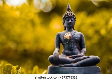 Buddha statue with nature bokeh background