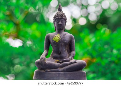 buddha statue on green background