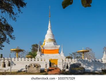 Buddha statue on mountain at Wat Phra That Kao Noi, Nan in Thailand