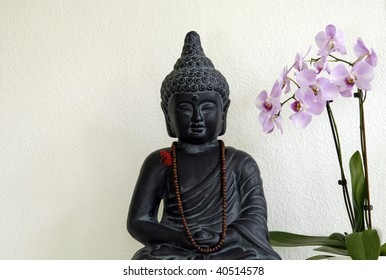 Buddha statue and Orchid at a private yoga studio