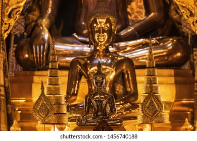 Buddha statue with other large buddha statues as a background in Pathum wanaram temple, Bangkok, Thailand
