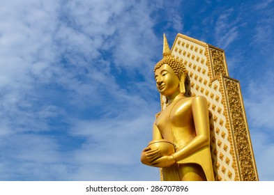 Buddha statue in Phitsanulok province and the blue sky in Thailand