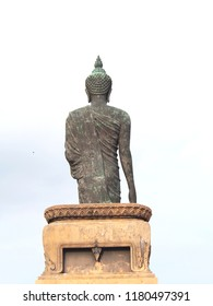 Buddha statue at Phutthamonthon District, Nakhon Pathom Province is a buddha in the posture of walking. Important day in buddhism people walk around 3 times with lighted candle in hand.