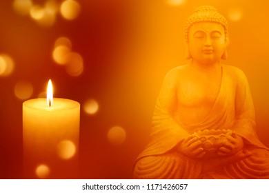 buddha statue with shiny candle light