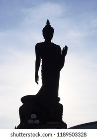 Buddha statue silhouette at Phutthamonthon,thailand is a buddha in the posture of walking.Important day in buddhism people walk around 3 times with lighted candle in hand.Close-up background.