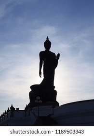 Buddha statue silhouette at Phutthamonthon,thailand is a buddha in the posture of walking.Important day in buddhism people walk around 3 times with lighted candle in hand.Medium shots  background.
