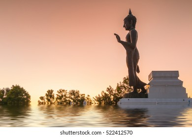 Buddha statue and the sunset in Phitsanulok, Thailand.