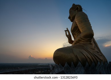 Buddha statue in sunset at  Temple Phetchaburi, Thailand.