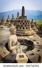 Buddha statue surrounded by stupas at Borobudur World Heritage Site