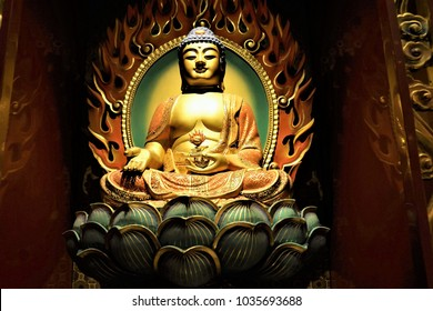 Buddha statue in tooth relict temple in china town in Singapore