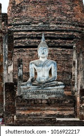 """Buddha Statue at the Wat Sa-Si Temple in the Historic Park of Sukhothai, Thailand. The  Park covers the ruins of Sukhothai, literally """"Dawn of Happiness"""", capital of the Sukhothai Kingdom."""