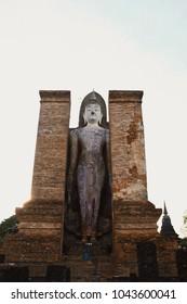 Buddha statue at Wat Sri Chum temple is ancient of world heritage Sukhothai Historical Park, Sukhothai province, Thailand