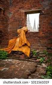 Buddha statue wearing orange robes