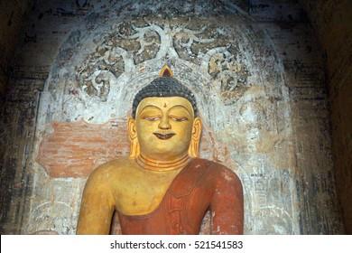 Buddha statue in Ywa Haung Gyi temple of red sandstone, Bagan Myanmar (Burma)