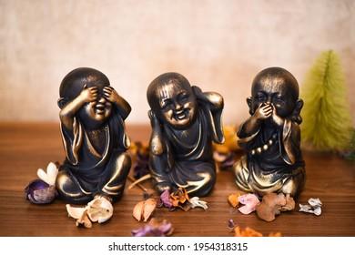 Buddha statues according to beliefs. Trinket decorative shot. Macro studio shot. Meditation, religious, asia statues. Asian culture.
