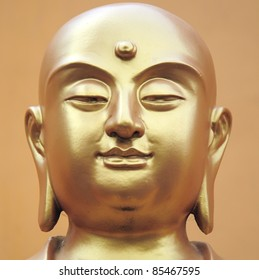 Buddha statue's face close-up