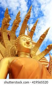 Buddha statues, large golden yellow. Against a backdrop of bright sky. Wat Khiri Wong is on his Daowadung. Muang. Nakhon Khiri Wong Temple is the holy Maha Chedi Phra Chedi Chula Manee.Thailand