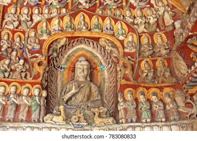 """Buddha statues of Yungang Grottoes : The UNESCO World cultural heritage site, Famous """"Buddhist Caves Art Treasure Houses"""" Datong, Shanxi Province, China. Selective focus."""