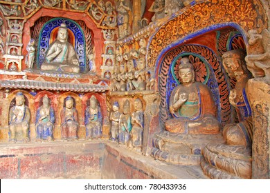 "Buddha statues of Yungang Grottoes : The World cultural heritage site, Famous ""Buddhist Caves Art Treasure Houses"", Datong, Shanxi Province, China. Selective focus."