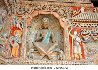 """Buddha statues of Yungang Grottoes : The World cultural heritage site, Famous """"Buddhist Caves Art Treasure Houses"""" in Datong, Shanxi Province, China. Selective focus."""