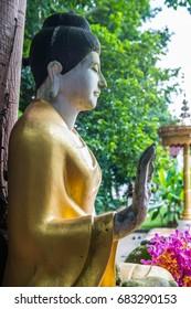 Buddha staue in Darabhirom Forest Monastery, Thailand.
