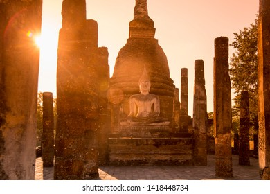 a Buddha with a stupa at the Wat Sa Si Temple at the Historical Park in Sukhothai in the Provinz Sukhothai in Thailand.   Thailand, Sukhothai, November, 2018