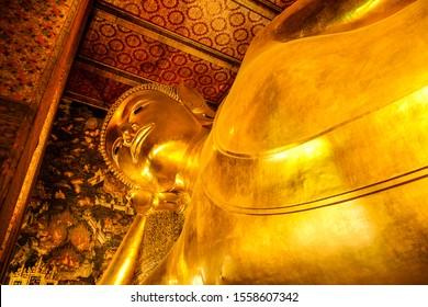 Buddha temple, Bangkok, Thailand - October 2018:  Statue of  golden sleeping Buddha, Buddha temple in Bangkok