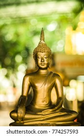 Buddha at the temple in Thailand.  And bokeh background.