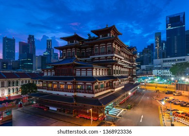 Buddha Tooth Relic Temple and Museum with dawn sunrise blue sky background, China town, Singapore.