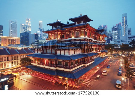 Buddha Toothe Relic Temple in Chinatown in Singapore, with Singapore`s business district in the background.