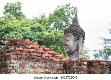 the Buddha at the Wat Si Chum at the Historical Park in Sukhothai in the Provinz Sukhothai in Thailand.   Thailand, Sukhothai, November, 2018