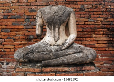 Buddha without head and red brick all in Ayuthaya, Thailand