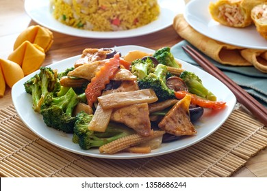 Buddha's delight sauteed mixed chinese vegetables with tofu served with chicken fried rice and an egg roll