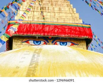 Buddha's eyes on the base of spire of Boudhanath Stupa close-up, Kathmandu, Nepal