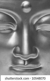 Buddha's face close up in black and white.