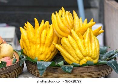 Buddha's hand fruit, fingered citron fruit, Citrus medica in street market, Yunnan province, china