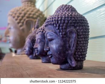 Buddha's head on wooden.