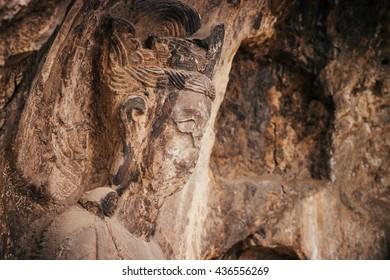 Buddha's statue rock carving in Longmen Grottoes at Yi River, Luoyang City, Henan province, China