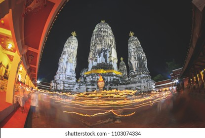Buddhism Candle Ceremony, Walk with lighted candles in hand around a temple