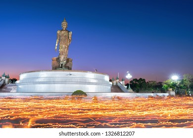 Buddhism light waving rite in Magha Puja, Day at Thailand. In Thailand, Buddhist candles are moving around the Buddha image in Phutthamonthon District, Nakhon Pathom Province.